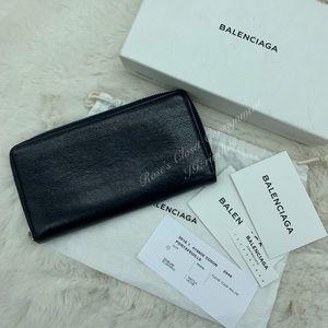 Authentic Balenciaga navy leather zippy wallet